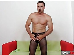 Muscular man in pantyhose fucks a toy tubes