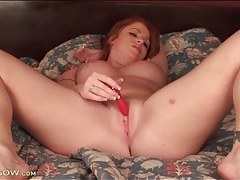 Buxom redhead with freckled tits fucks a toy tubes