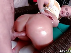 Big butt girl oiled up and fucked by a toy tubes
