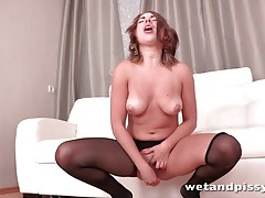 Beautiful girl in ripped pantyhose pissing tubes