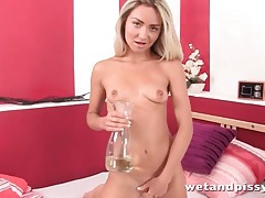 Hottie pours piss onto her sexy tits tubes
