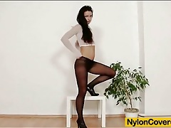 Black dildo fucks brunette in crotchless hose tubes