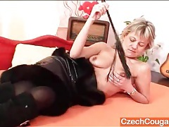 Dominant mature in a leather dress and boots tubes