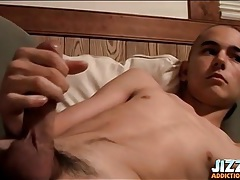 Shaved head skinny boy strokes his big cock tubes