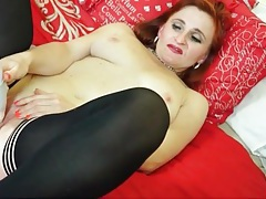 Redhead older lady loves her vibrator tubes