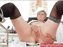 Granny sits in stirrups and fingers her cunt tubes