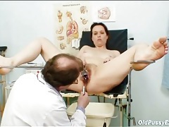 Doctor looks deep inside her mature pussy tubes