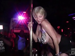 Amateurs dance on the pole at a club party tubes