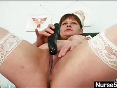 Fat body nurse stuffs toy into her cunt tubes