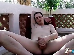 Cumshot on his sexy feet in outdoor scene tubes
