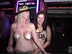 Costume girls and topless chicks at street party tubes