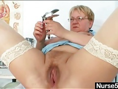 Chubby old babe in glasses toys her pussy tubes