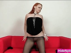 Redhead in sexy boots puts on her pantyhose tubes