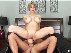 Huge fake tits babe in leather boots rides dick tubes