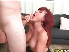 Curvy mature redhead with fake tits sucks dick tubes