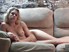 Blonde coed strips nude on the couch tubes