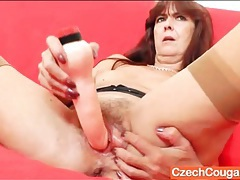 Mature pussy spreads around her dildo tubes