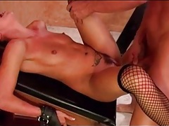 Small tits girl in fishnets bent over and laid tubes