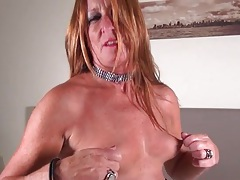Sultry mature redhead in sexy black pantyhose tubes