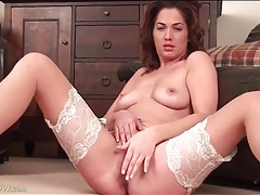 Her lace top stockings are sexy in solo porn tubes