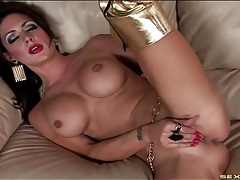 Heavy makeup and slutty boots on a pornstar tubes