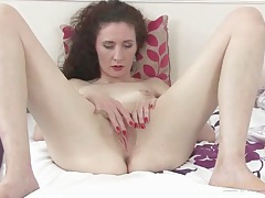 Sultry older lady strips off her panties to finger tubes