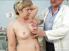 Shaved granny toys her pussy as doctor watches tubes