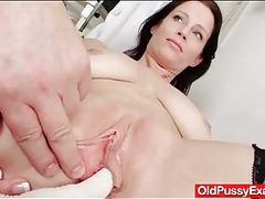 Busty milf beauty opens her legs for a pussy exam tubes