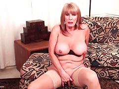 Big boobs solo mature masturbates in stockings tubes