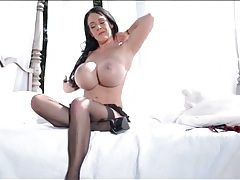 Babe with giant fake tits teases her sexy stockings tubes