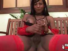 Red lingerie is dazzling on a black shemale tubes