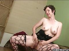 Cute milf dresses up in black lingerie to seduce tubes