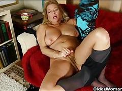 Pantyhose mama plays with her big titties tubes