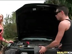 Mechanic works the car and those big bimbo tits tubes