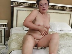 Old chick is horny and alone so she fingers her cunt tubes
