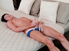 Cute twink alone in bed and stroking his shaft tubes