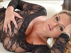 Skintight black lace clings to her huge tits tubes