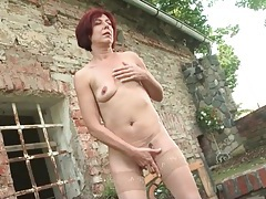 Old lady alone outdoors and masturbating her cunt tubes