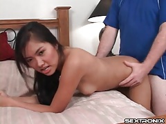 He holds tight to her asian hips and fucks her doggystyle tubes