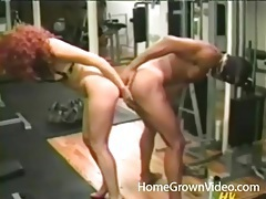 Hot redhead and a guy share a double dildo tubes