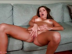 Two fingers in her slippery pussy as she fondles her tits tubes