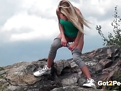 Sporty chick stops her hike to pee outdoors tubes