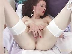 Elegant older lady in white stockings fingers her box tubes