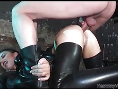 Latex slut pounded in the ass and taking a big load tubes