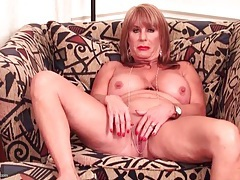 Sexy mama with amazing tits plays with her cunt tubes