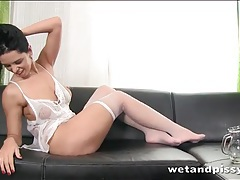 Babe pisses and pours it on her tits tubes