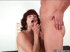 Classy mature redhead goes down on his dick tubes