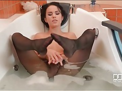 Beauty takes a bath in her black pantyhose tubes
