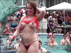 Topless girls dance at a pool party tubes