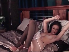 Black stockings with lace tops on a leggy beauty tubes